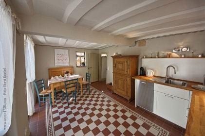 The kitchen has a dishwasher, an oven, a refridgerator with a freezing compartment, a microwave, a sink, a ceramic glass cooktop, a water boiler, a coffee machine (Dulce Gusto, we provide some capsules), a toaster, a french press, cutlery, glasses of all sorts, plates and many more.