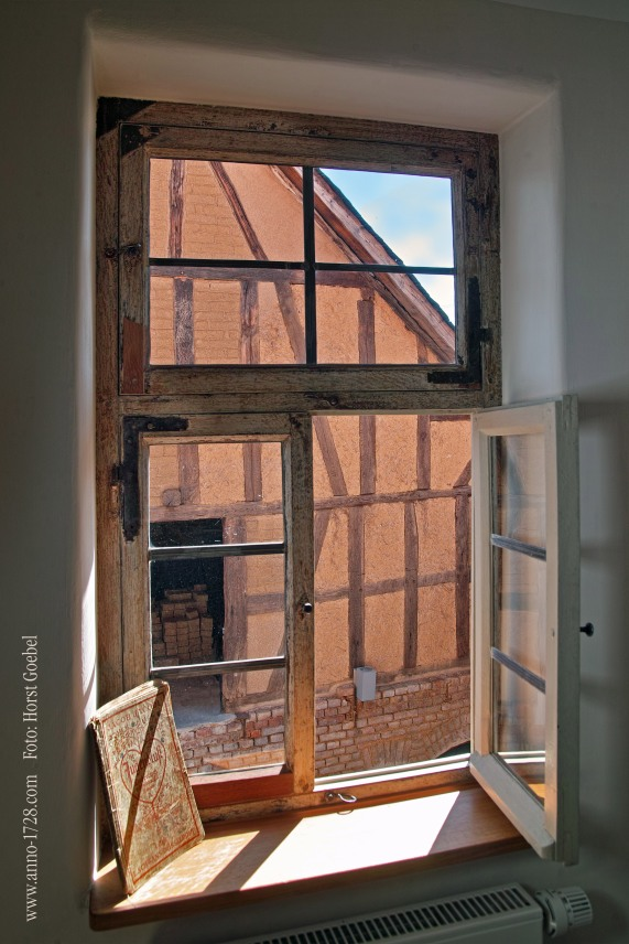 This window is even older than 1728. Windows were very valuable back then. This window was brought into the house.